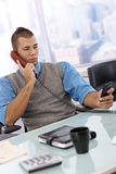 Businessman busy using phone Stock Photos