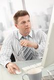 Businessman busy working in office Stock Photos