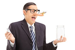 Businessman with butterfly on his nose holding a jar Royalty Free Stock Photography