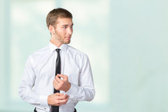 Businessman buttoning cuff sleeves Royalty Free Stock Photography