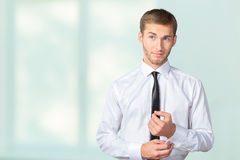 Businessman buttoning cuff sleeves Stock Image