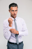 Businessman buttoning cuff sleeves Stock Photos