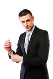 Businessman buttoning cuff sleeves Royalty Free Stock Images