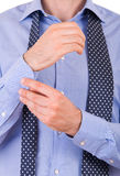 Businessman buttoning his sleeve. Stock Photography