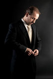 Businessman buttoning jacket, getting dressed. Stock Photography