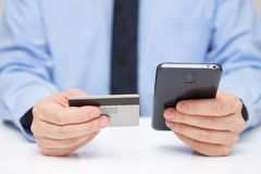 Businessman is buying application  with  credit card on mobile p Royalty Free Stock Photography