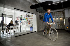 Businessman on the bycicle. Young businessman on the bycicle Stock Photography