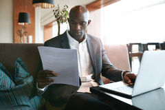 Businessman at cafe preparing himself for a meeting Royalty Free Stock Image