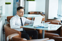 Businessman in cafe Royalty Free Stock Photos