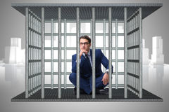 The businessman in the cage business concept Stock Images