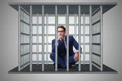 The businessman in the cage business concept Stock Image