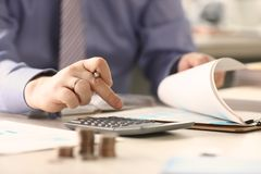 Businessman Calculate Funds Tax Report Concept. Accountant Married Man Counting Financial Data Using Calculator, Chart. Corporate Analyzes Economy Balance royalty free stock photography