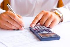 Businessman calculating Stock Photo