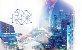 Businessman calculating budget before signing real estate project contract .double exposure style house polygon line. stock photos