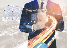 Businessman calculating budget before signing real estate project contract .double exposure style house polygon line. royalty free stock photo