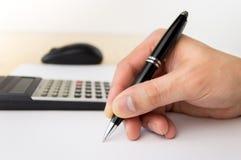 Businessman calculating Royalty Free Stock Photos