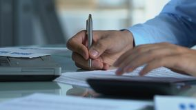 Businessman calculating companys taxes, filling out annual statement, finances. Stock footage stock video footage