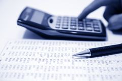 Businessman calculating expense Stock Images