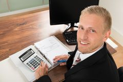 Businessman calculating finance Royalty Free Stock Image