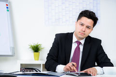 Businessman Calculating Financial Data Royalty Free Stock Photo