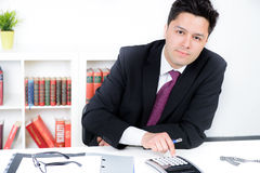Businessman Calculating Financial Data At Desk Royalty Free Stock Photos