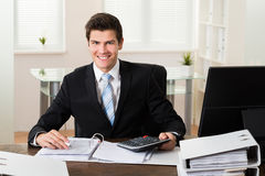 Businessman Calculating Financial Data Royalty Free Stock Photography