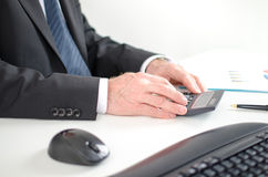 Businessman calculating financial results Royalty Free Stock Images