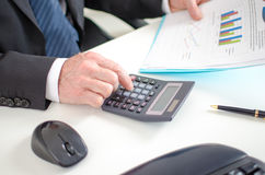 Businessman calculating financial results Royalty Free Stock Photos