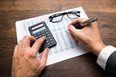 Businessman Calculating Financial Sheet Royalty Free Stock Photography