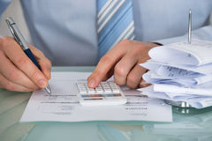 Businessman Calculating Invoice Royalty Free Stock Image