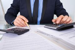 Businessman calculating invoices Royalty Free Stock Images