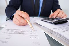 Businessman Calculating Invoices Stock Images