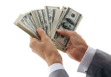 Businessman calculating money. Hands of businessman calculating money Royalty Free Stock Photography