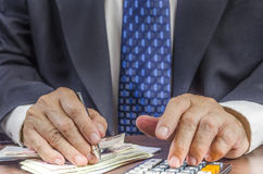 Businessman calculating profit. Business people calculating profit - closeup shot of hands using calculator : Concept for Business and Money Royalty Free Stock Photography