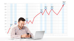 Businessman calculating stock market with rising graph in the ba Stock Photo