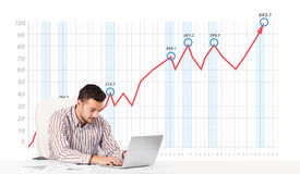 Businessman calculating stock market with rising graph in the ba Royalty Free Stock Photo