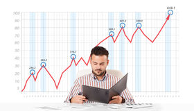 Businessman calculating stock market with rising graph Royalty Free Stock Photography