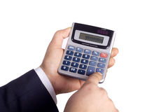 Businessman Calculating. Businessman Using a calculator isolated on white Royalty Free Stock Images