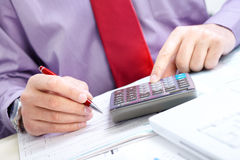 Businessman. Calculator Stock Images