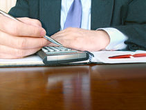Businessman with calculator. Stock Images