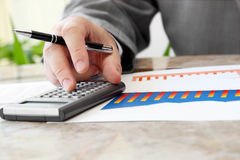 Businessman with Calculator Royalty Free Stock Photos