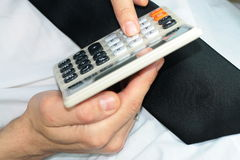Businessman with calculator. Hands of businessman with black tie and calculator Royalty Free Stock Photos