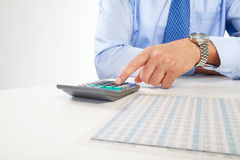 The businessman and calculator Royalty Free Stock Images