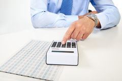 The businessman and calculator Royalty Free Stock Photo