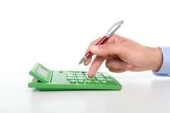 The businessman and calculator Stock Image