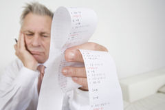 Businessman With Calculator Paper Stock Photography