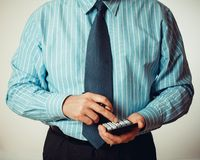 Businessman with calculator and pen in blue shirt Stock Photo