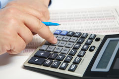 The businessman and calculator Stock Images