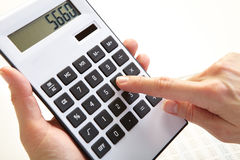 The businessman and calculator Royalty Free Stock Photos