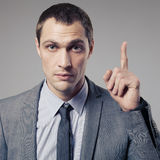 Businessman call for attention on gray background Stock Images